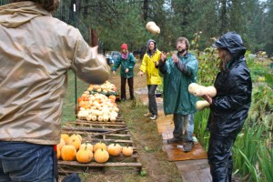 Look at this picture from this same date last year. Totally raining. And look at all those unprepared and inappropriately dressed farmers! Turns out that tossing squash during the first rain is just as much fun as jumping in puddles!
